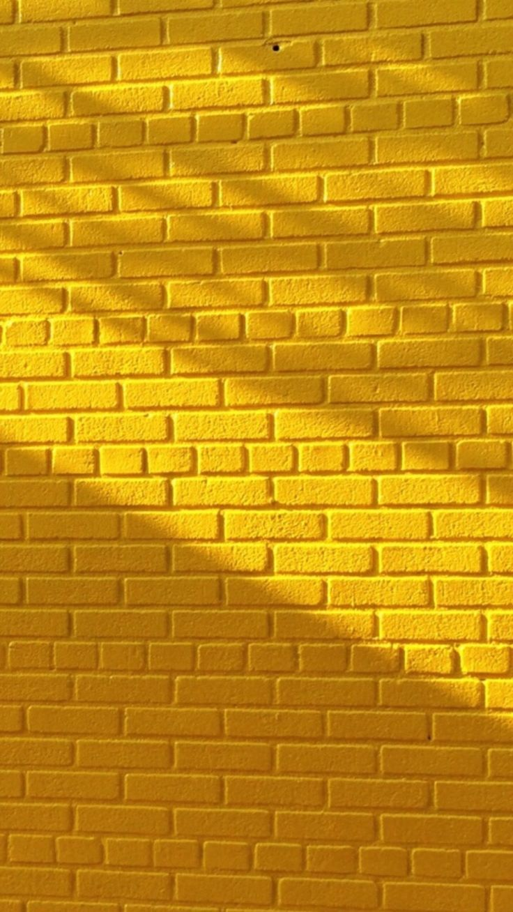 736x1308 Yellow brick wall with beautiful lighting | Wallpapers for ...