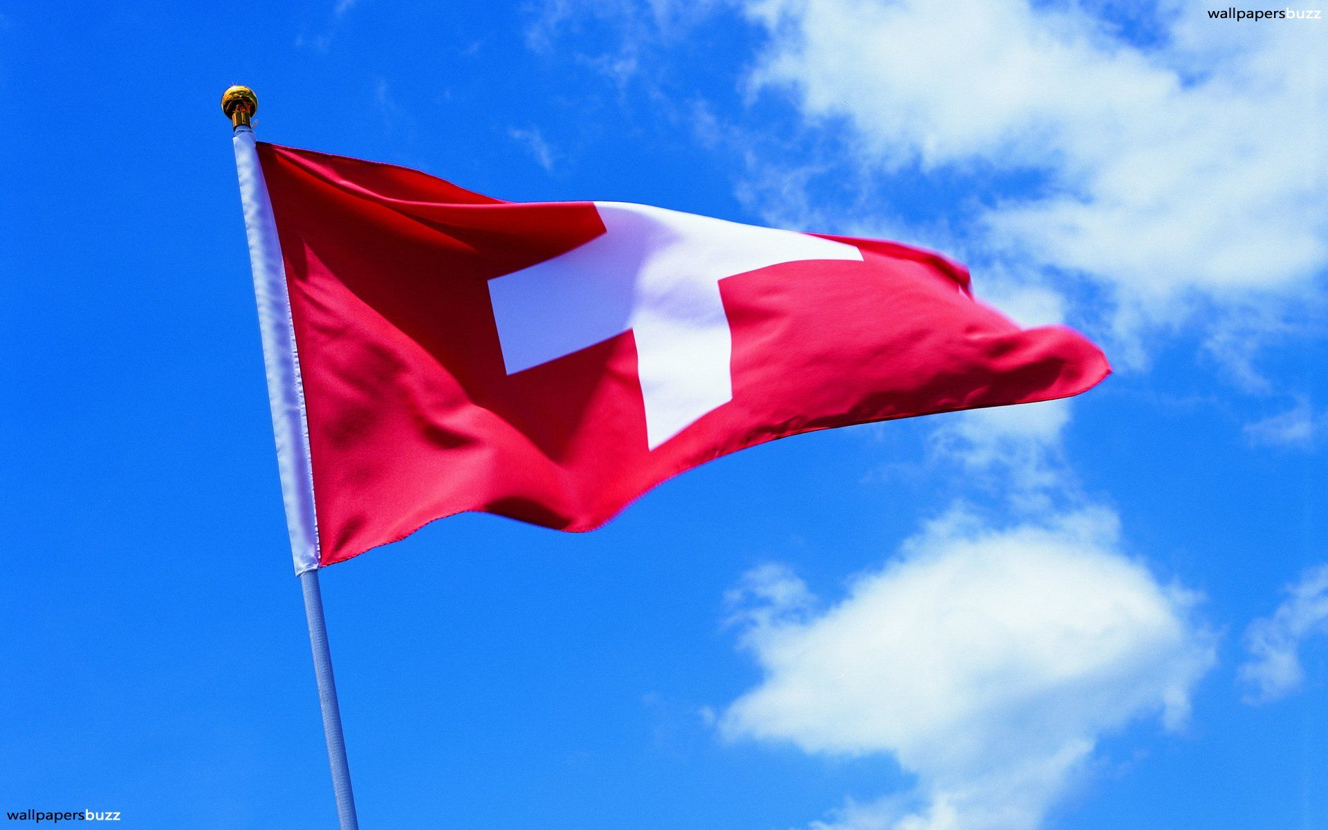 1920x1200 The flag of Switzerland on the flagpole HD Wallpaper
