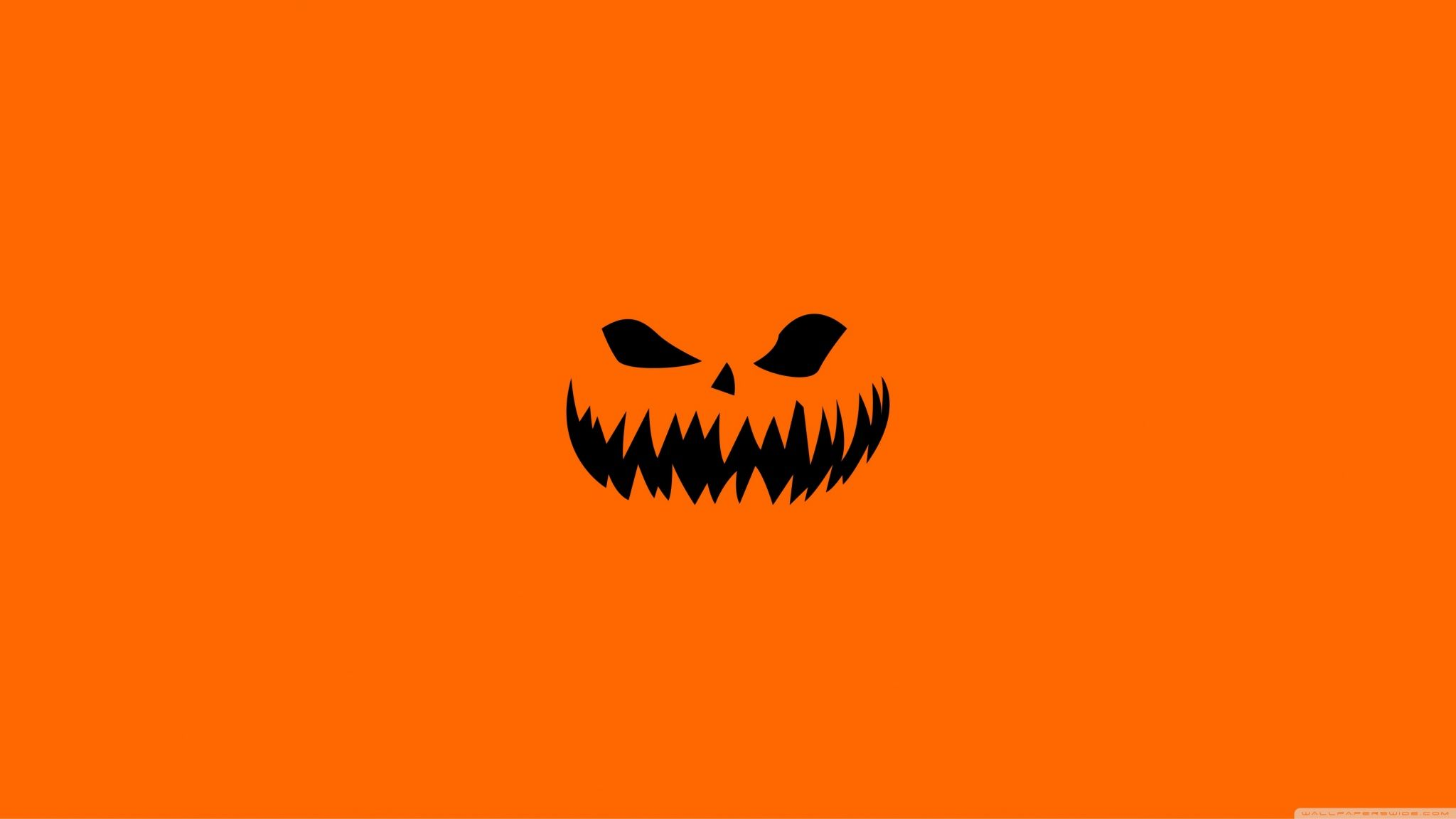 2048x1152 Scary Halloween Face on Orange Background Wallpapers ...