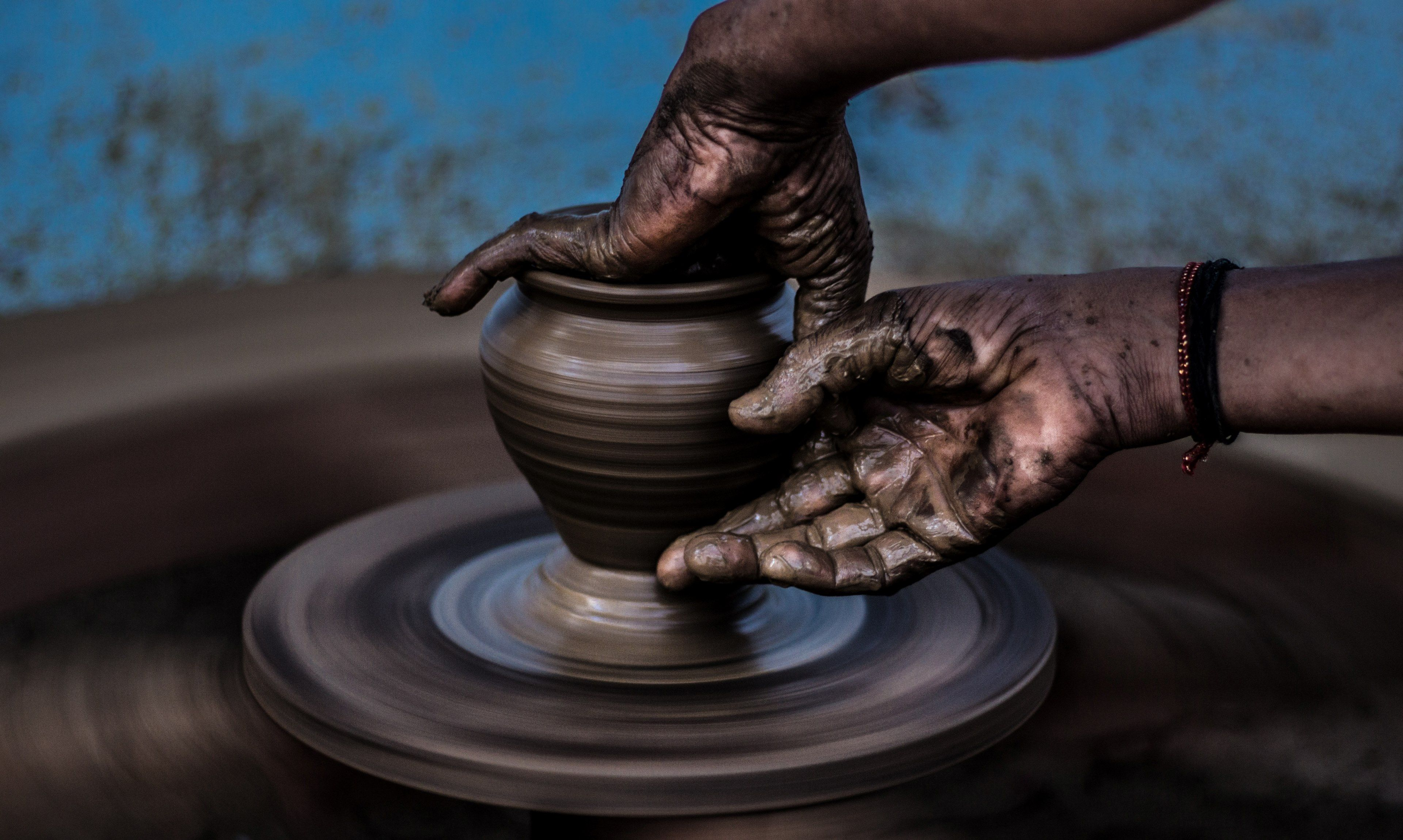 3840x2299 hands create art on a pottery wheelmud games 4k wallpaper and background